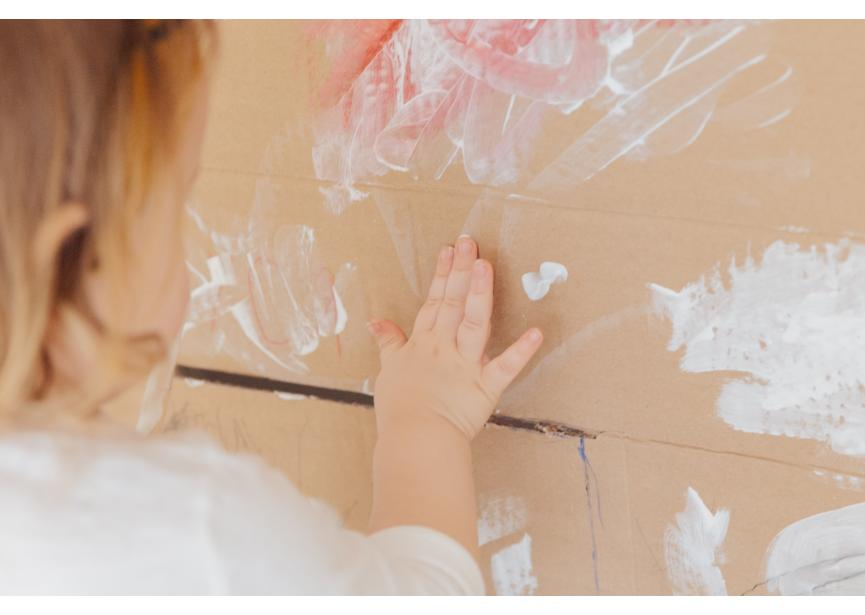 crop-anonymous-child-drawing-with-white-paint-at-home-3933257